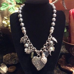 Whimsical large chunky silver charm necklace